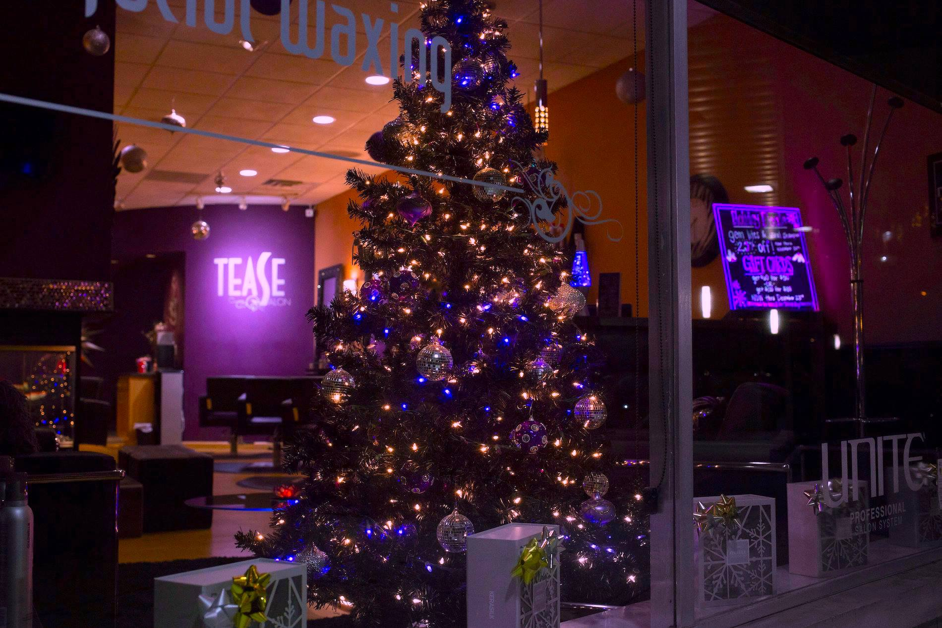 while youre here why not get an amazing new color or cutthen you get to pick out a gift from under the tree tagged black christmas - Black Christmas Tree With Purple Decorations